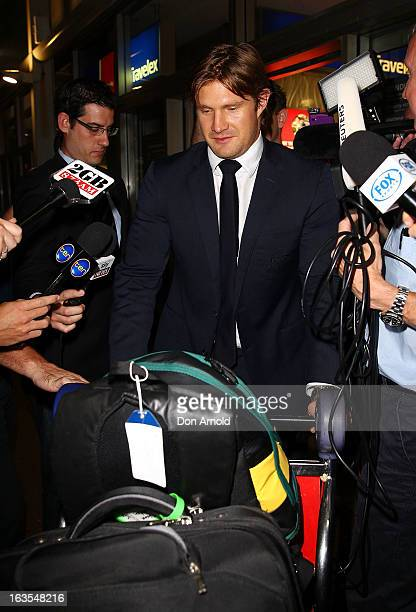 Shane Watson arrives at Sydney International Airport on March 12 2013 in Sydney Australia Watson returned home after disciplinary action in place...