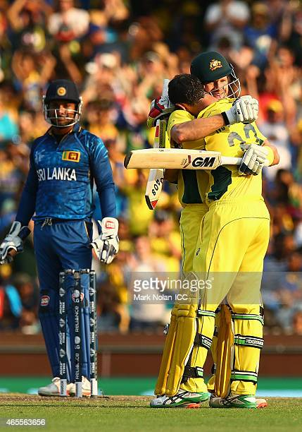 Shane Watson of Australia and Glenn Maxwell of Australia embrace after Maxwell scored a century during the 2015 ICC Cricket World Cup match between...