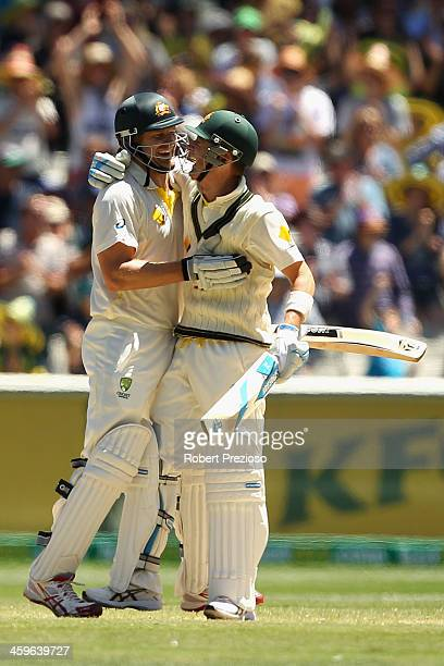 Shane Watson of Australia and Michael Clarke of Australia celebrate winning the match during day four of the Fourth Ashes Test Match between...