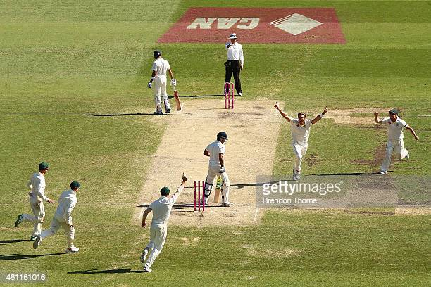 Shane Watson of Australia celebrates after claiming the wicket of Suresh Raina of India during day three of the Fourth Test match between Australia...