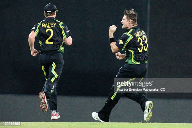Shane Watson of Australia celebrates after getting the wicket of Chris Gayle during the ICC World Twenty20 Group A match between Australia and the...