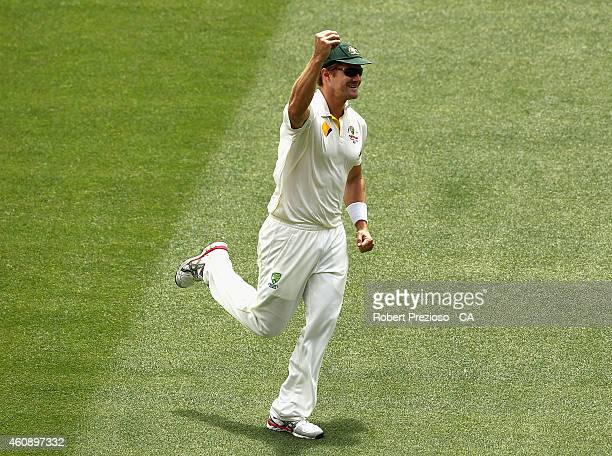 Shane Watson of Australia celebrates after taking a catch to dismiss Lokesh Rohul of India off the bowling of Mitchell Johnson of Australia during...