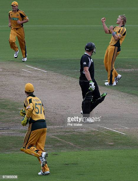 Shane Watson of Australia celebrates his wicket of Ross Taylor of New Zealand as Scott Styris looks on during the One Day International match between...