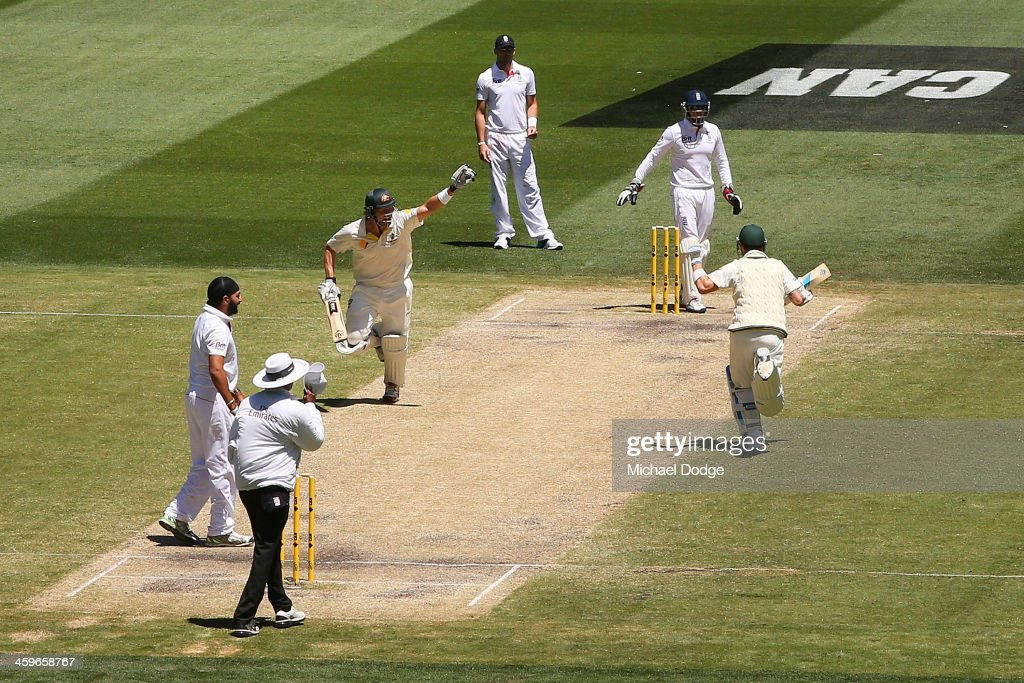 Shane Watson (L) of Australia celebrates hitting the winning runs with Michael Clarke during day four of the Fourth Ashes Test Match between Australia and England at Melbourne Cricket Ground on December 29, 2013 in Melbourne, Australia.