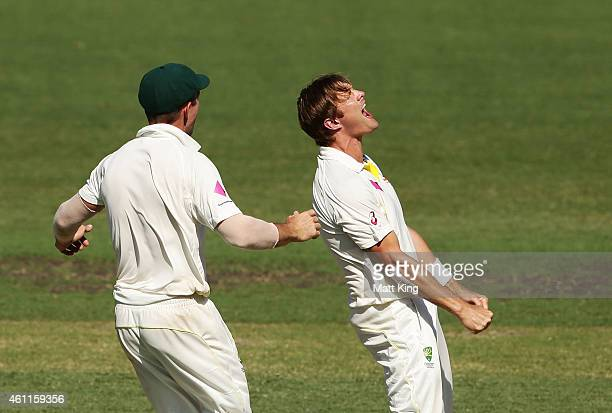 Shane Watson of Australia celebrates taking the wicket of Ajinkya Rahane of India during day three of the Fourth Test match between Australia and...