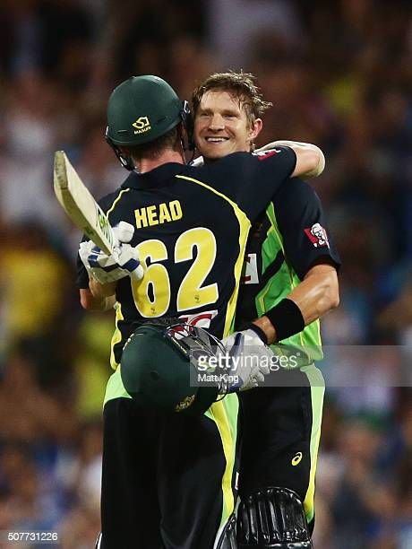 Shane Watson of Australia celebrates with Travis Head of Australia after scoring a century during the International Twenty20 match between Australia...