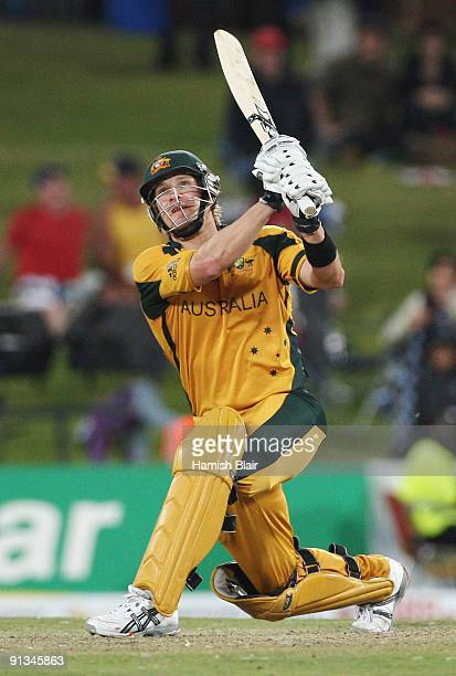 Shane Watson of Australia hits a six from the bowling of Paul Collingwood during the ICC Champions Trophy 1st Semi Final match between Australia and...