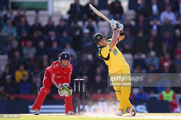 Shane Watson of Australia hits a six off the bowling of James Tredwell of England as wicketkeeper Jos Buttler looks on during the 5th NatWest Series...