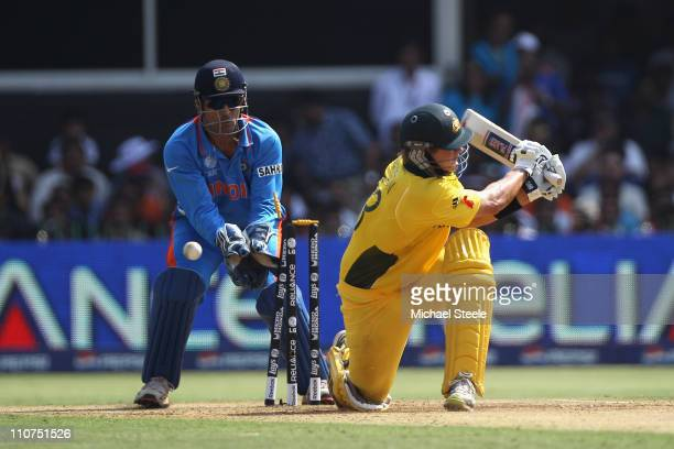 Shane Watson of Australia is bowled by Ravichandran Ashwin during the 2011 ICC World Cup QuarterFinal match between Australia and India at the Sardar...
