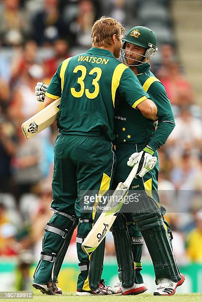 Shane Watson of Australia is congratulated by Phil Hughes after scoring a century during the Commonwealth Bank One Day International Series between...