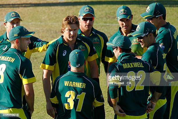 Shane Watson of Australia is congratulated by teammates after taking the wicket of Faf Du Plessis of South Africa during game one of the men's one...