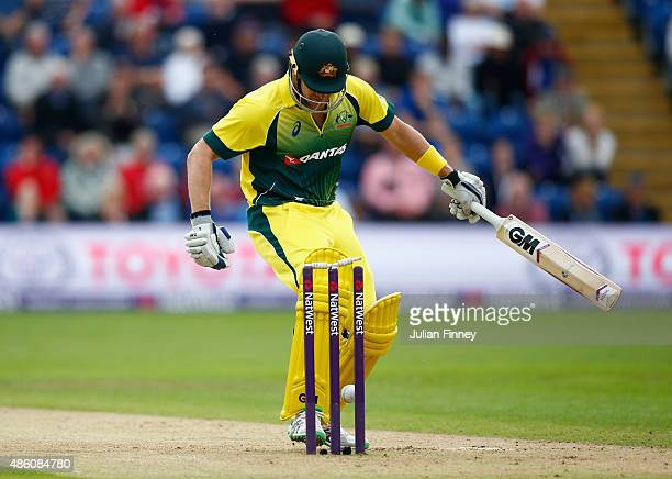 Shane Watson of Australia kicks the ball onto his own stumps off the bowling of Steven Finn of England during the NatWest T20 International match...