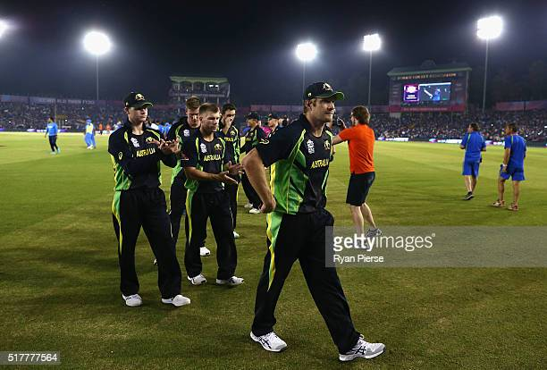 Shane Watson of Australia leads his tim from the ground after his last match of International cricket during the ICC WT20 India Group 2 match between...