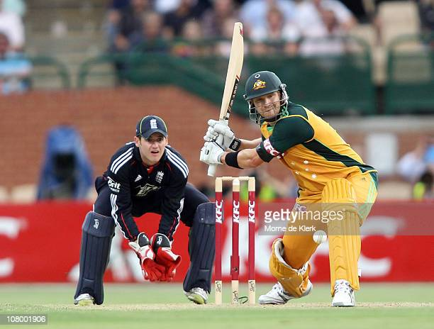 Shane Watson of Australia prepares to hit a delivery from Graeme Swann of England for six runs during the First Twenty20 International Match between...