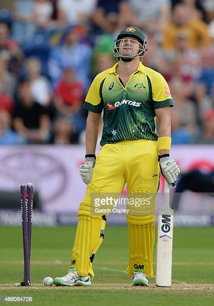 Shane Watson of Australia reacts after being bowled by Steven Finn of England during the NatWest T20 International match between England and...
