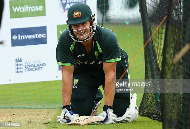Shane Watson of Australia recovers after being hit while batting during a nets session ahead of the 1st Investec Ashes Test match between England and...