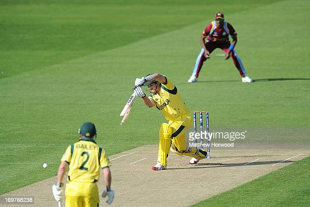 Shane Watson of Australia snaps his bat while batting during the West Indies v Australia - ICC Champions Trophy Warm Up match at the SWALEC Stadium...