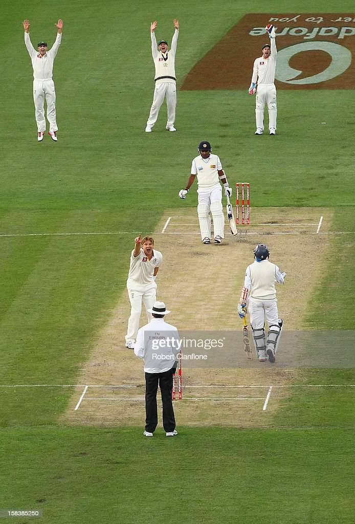 Shane Watson of Australia takes the wicket of Mahela Jayawardene of Sri Lanka during day two of the First Test match between Australia and Sri Lanka at Blundstone Arena on December 15, 2012 in Hobart, Australia.
