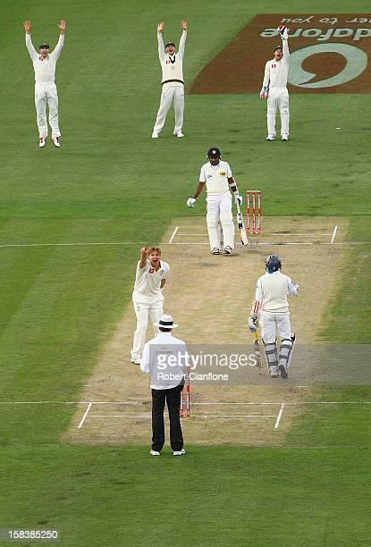 Shane Watson of Australia takes the wicket of Mahela Jayawardene of Sri Lanka during day two of the First Test match between Australia and Sri Lanka...