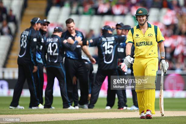 Shane Watson of Australia walks back to the pavillion after being icaught behind by wicketkeeper Luke Ronchi off the bowling of Mitchell McClenaghan...