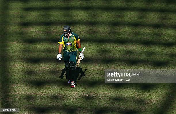 Shane Watson of Australia walks from the field after being dismissed during game three of the One Day International Series between Australia and...