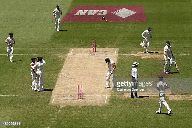 Shane Watson of Australia walks off the field after being dismissed by Mohammed Shami of India during day two of the Fourth Test match between...