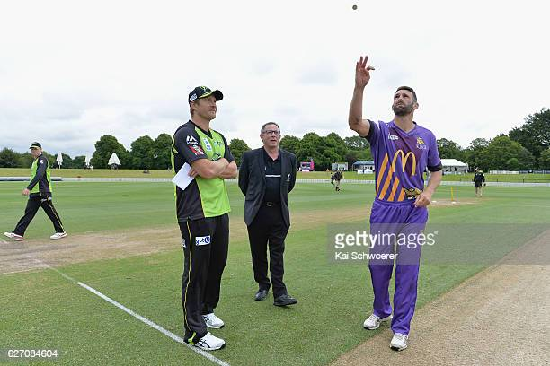Shane Watson of the Thunder and Andrew Ellis of the Kings take part in the coin toss prior to the T20 practice match between Canterbury Kings and...