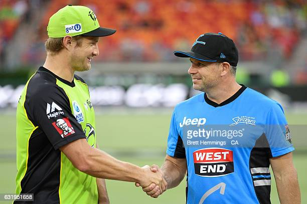 Shane Watson of the Thunder and Brad Hodge of the Strikers shake hands prior to the Big Bash League match between the Sydney Thunder and the Adelaide...