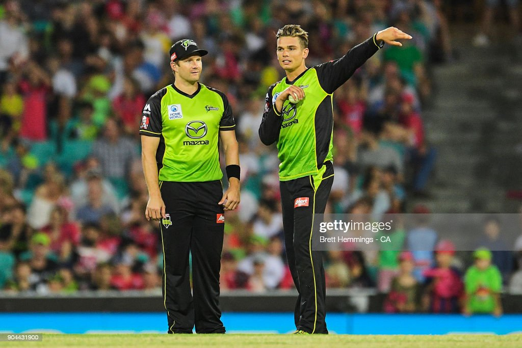 Shane Watson of the Thunder and Chris Green of the Thunder speak during the Big Bash League match between the Sydney Sixers and the Sydney Thunder at Sydney Cricket Ground on January 13, 2018 in Sydney, Australia.