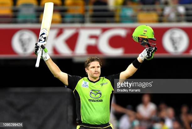 Shane Watson of the Thunder celebrates scoring a century of runs during the Big Bash League match between the Brisbane Heat and the Sydney Thunder at...