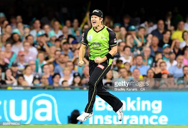 Shane Watson of the Thunder celebrates taking the catch to dismiss Ben Cutting of the Heat during the Big Bash League match between the Brisbane Heat...