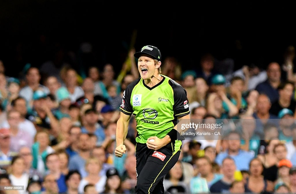 Shane Watson of the Thunder celebrates taking the catch to dismiss Ben Cutting of the Heat during the Big Bash League match between the Brisbane Heat and the Sydney Thunder at The Gabba on December 27, 2017 in Brisbane, Australia.