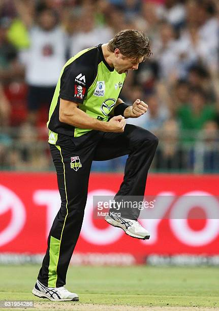 Shane Watson of the Thunder celebrates taking the wicket of Ben Dunk of the Strikers during the Big Bash League match between the Sydney Thunder and...