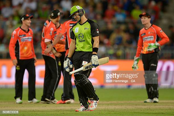 Shane Watson of the Thunder looks dejected as he leaves the field after being dismissed by Andrew Tye of the Scorchers during the Big Bash League...