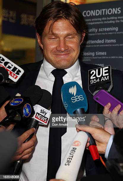 Shane Watson stops to answer questions from the media upon arrival at Sydney International Airport on March 12 2013 in Sydney Australia Watson...
