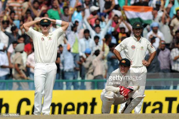 Shane Watson Tim Paine and captain Ricky Ponting of Australia look dejected during day five of the First Test match between India and Australia at...