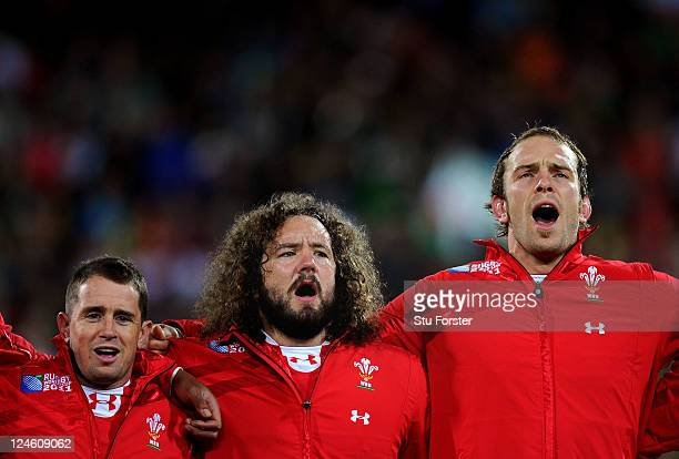 Shane Williams, Adam Jones and Alun Wyn Jones of Wales sing their national anthem prior to kickoff during the IRB 2011 Rugby World Cup Pool D match...