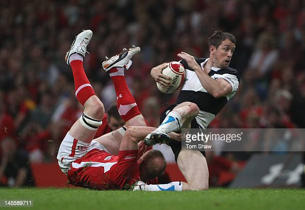 Shane Williams of the Barbarians is tackled during the international match between Wales and The Barbarians at Millennium Stadium on June 2 2012 in...