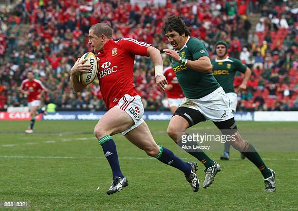 Shane Williams of the British & Irish Lions beats Jaque Fourie of South Africa on his way to scoring his second try during the Third Test Match...