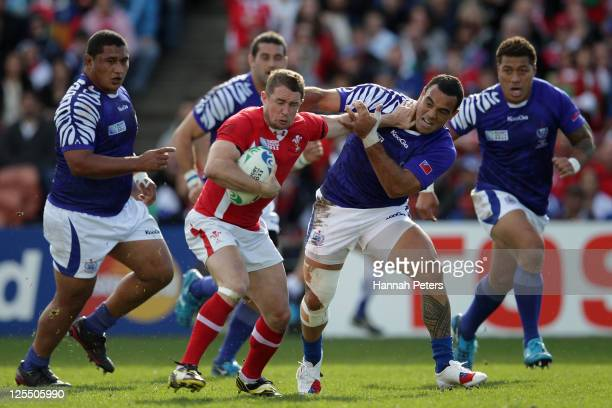 Shane Williams of Wales charges forward past Kahn Fotuali'i of Samoa during the IRB 2011 Rugby World Cup Pool D match between Wales and Samoa at...