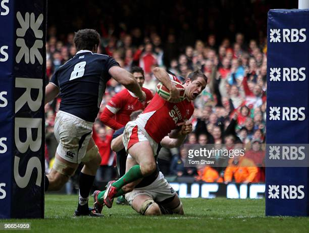 Shane Williams of Wales dives over the line to score the winning try during the RBS 6 Nations match between Wales and Scotland at the Millennium...