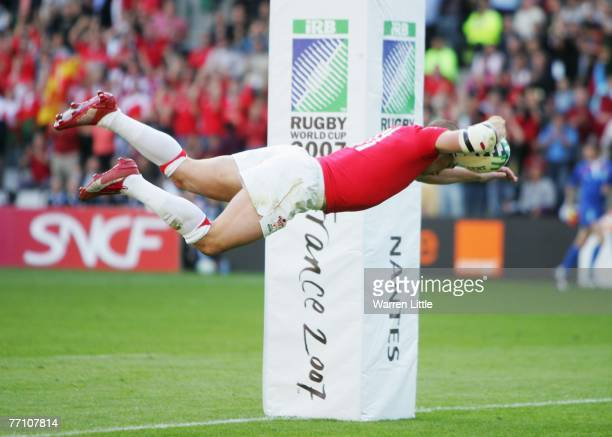 Shane Williams of Wales dives over to score his team's second try during the Rugby World Cup 2007 Pool B match between Wales and Fiji at the Stade de...