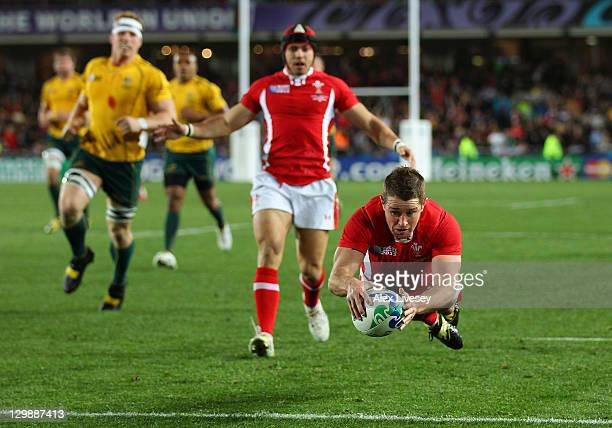 Shane Williams of Wales goes over to score a try during the 2011 IRB Rugby World Cup bronze final match between Wales and Australia at Eden Park on...