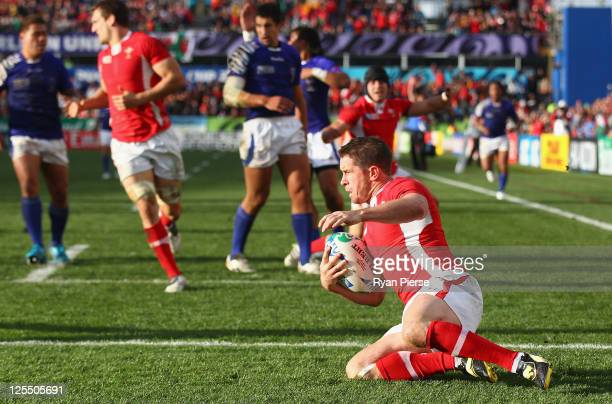 Shane Williams of Wales goes over to score their first try during the IRB 2011 Rugby World Cup Pool D match between Wales and Samoa at Waikato...