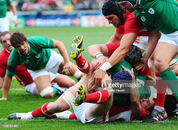 Shane Williams of Wales holds up Sean O'Brien of Ireland to prevent a try during quarter final one of the 2011 IRB Rugby World Cup between Ireland v...