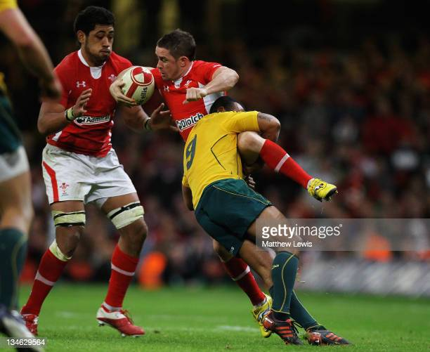 Shane Williams of Wales is tackled by Will Genia of Australia during the Test match between Wales and the Australian Wallabies at Millennium Stadium...