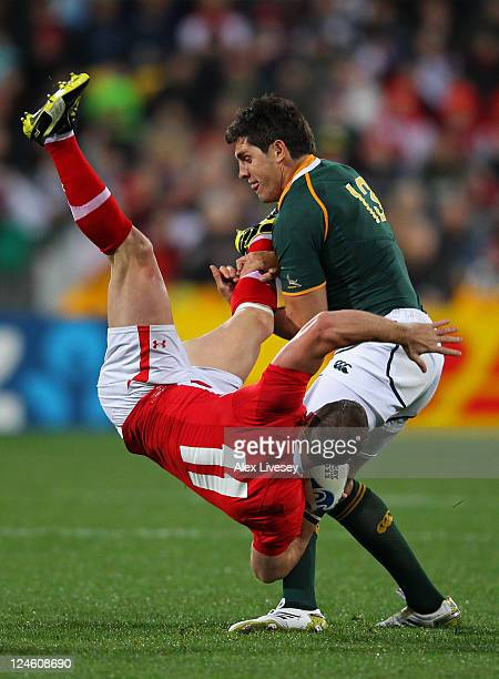 Shane Williams of Wales is upended by Jacque Fourie of South Africa during the IRB 2011 Rugby World Cup Pool D match between South Africa and Wales...