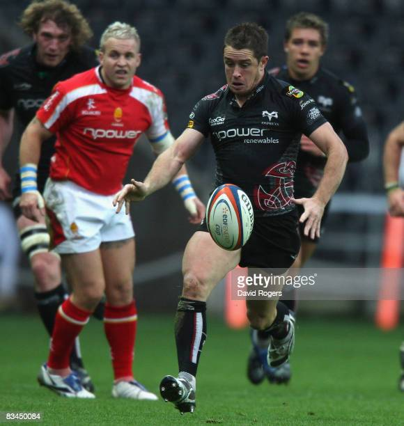 Shane Williams, the Ospreys wing, kicks the ball upfield during the EDF Energy Cup match between Ospreys and Worcester Warriors at the Liberty...