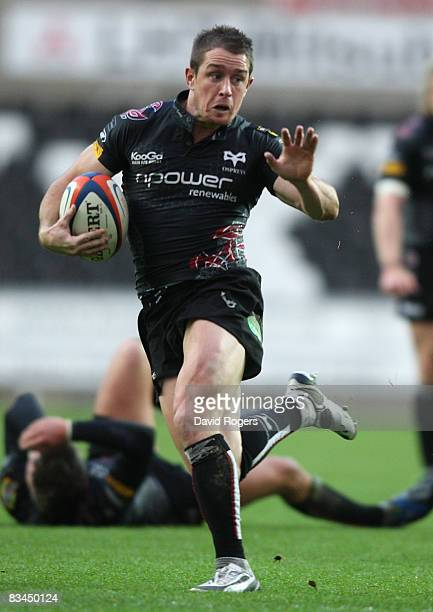 Shane Williams the Ospreys wing runs with the ball during the EDF Energy Cup match between Ospreys and Worcester Warriors at the Liberty Stadium on...