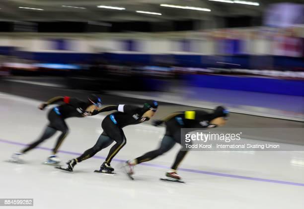 Shane Williamson Shota Nakamura and Ryosuke Tsuchiya of Japan race to a second place finish during the ISU World Cup Speed Skating Championships...